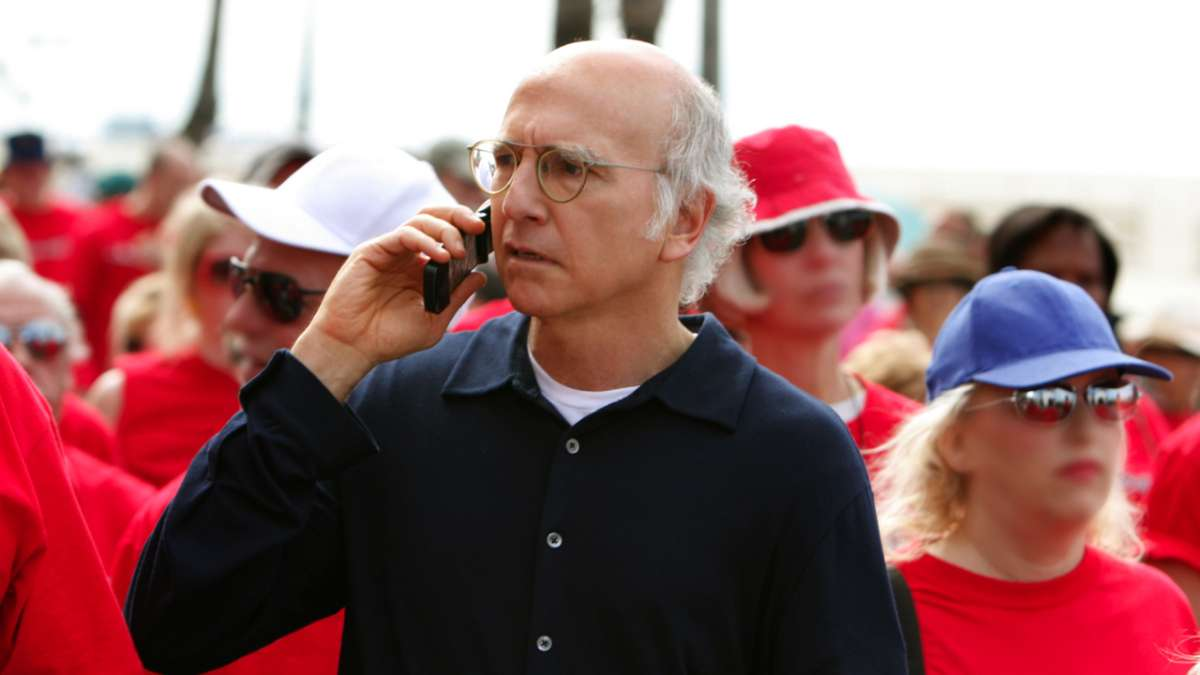 Larry David on cell phone people in red shirts