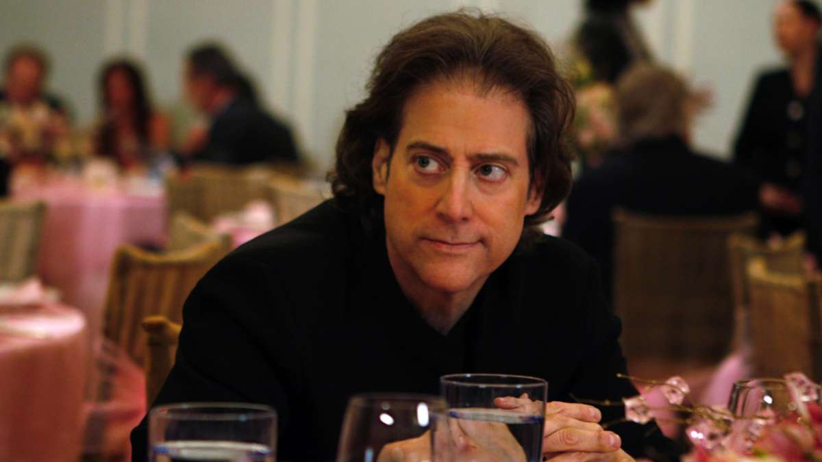 Richard Lewis sitting at table at bat mitzvah