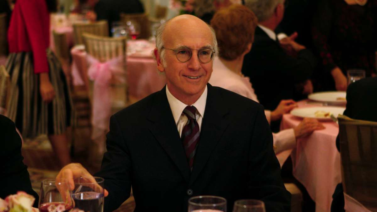 Larry David smiling at bat mitzvah table