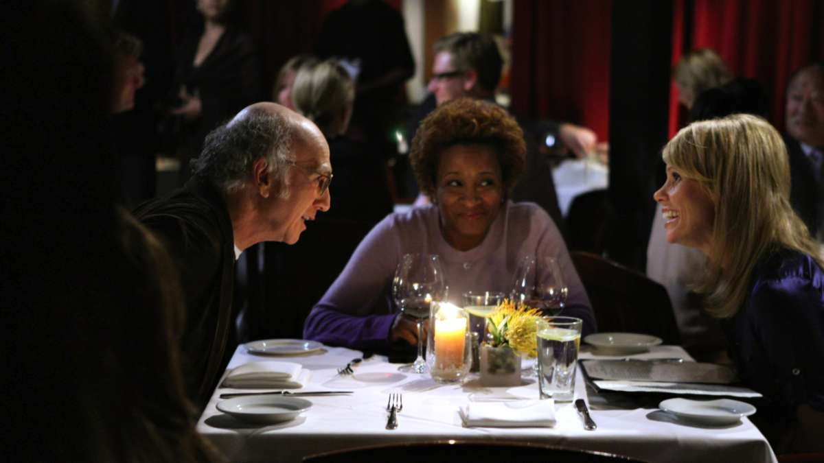 """Larry David, Wanda and Cheryl at restaurant table"""