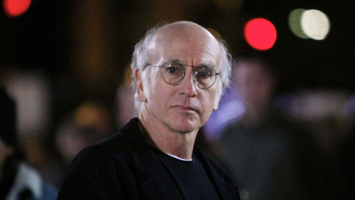 Larry David frowns at night