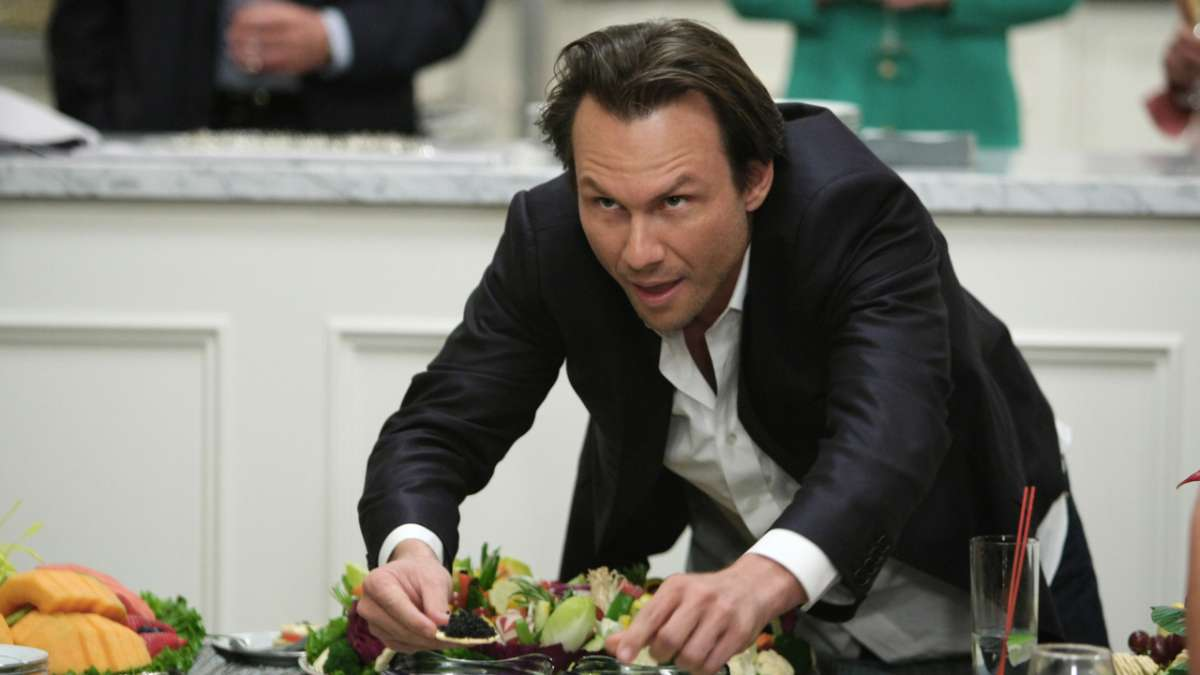 Christian Slater eating caviar at party