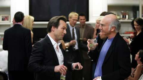 Christian Slater and Larry David at party