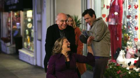 Larry David woman in wheelchair and couple on sidewalk laughing