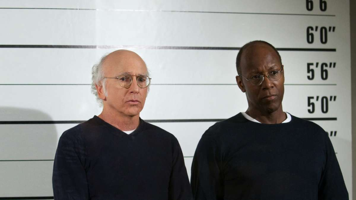 Larry David and African American man in police line-up