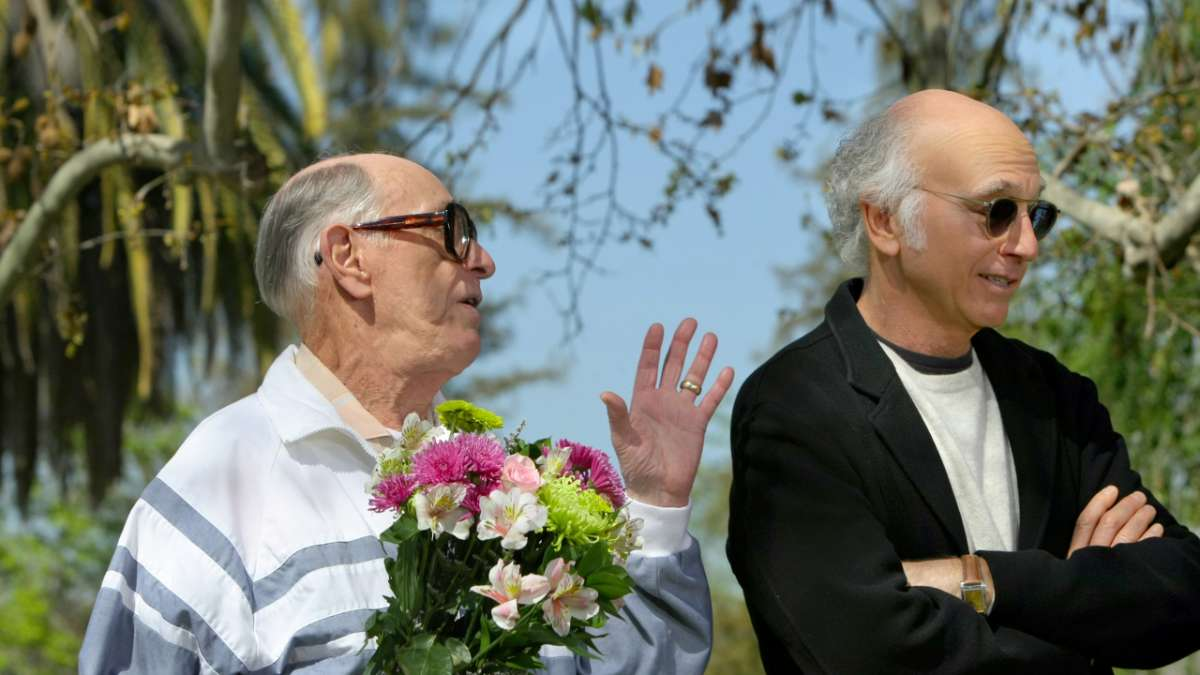 Larry David and his dad with flowers