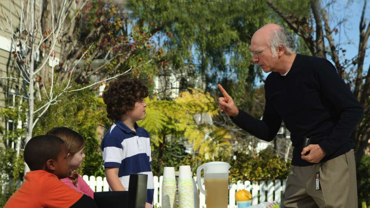 Larry David and kids selling lemonade