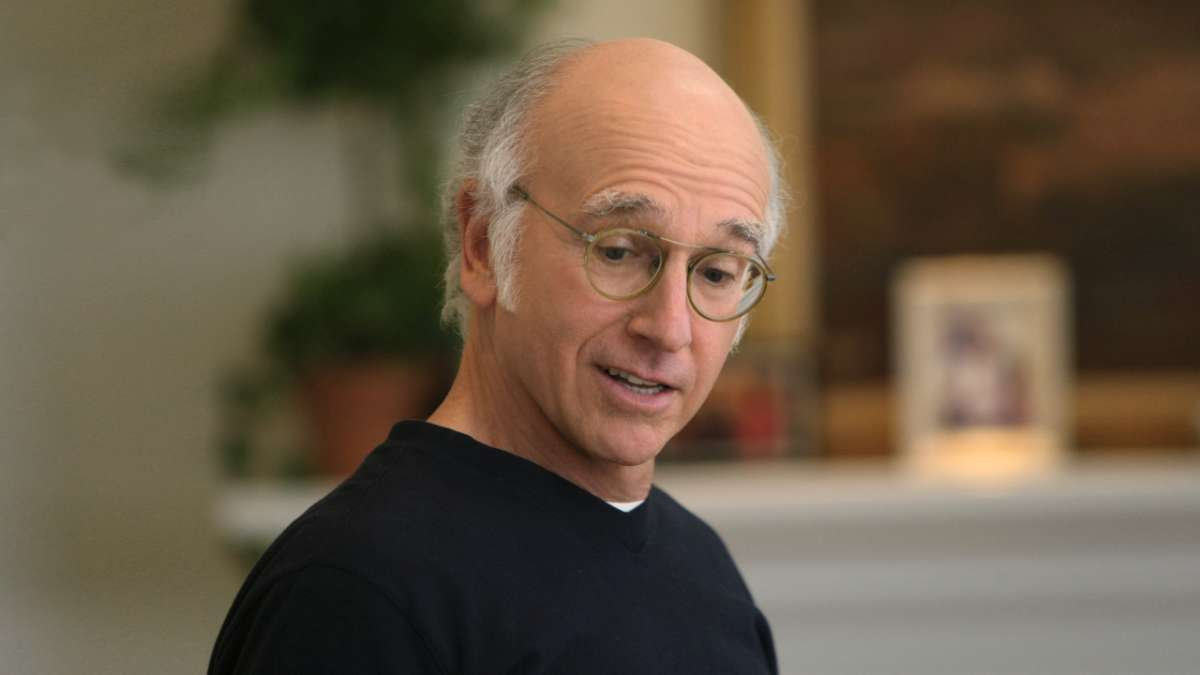 Larry David looks down smiles