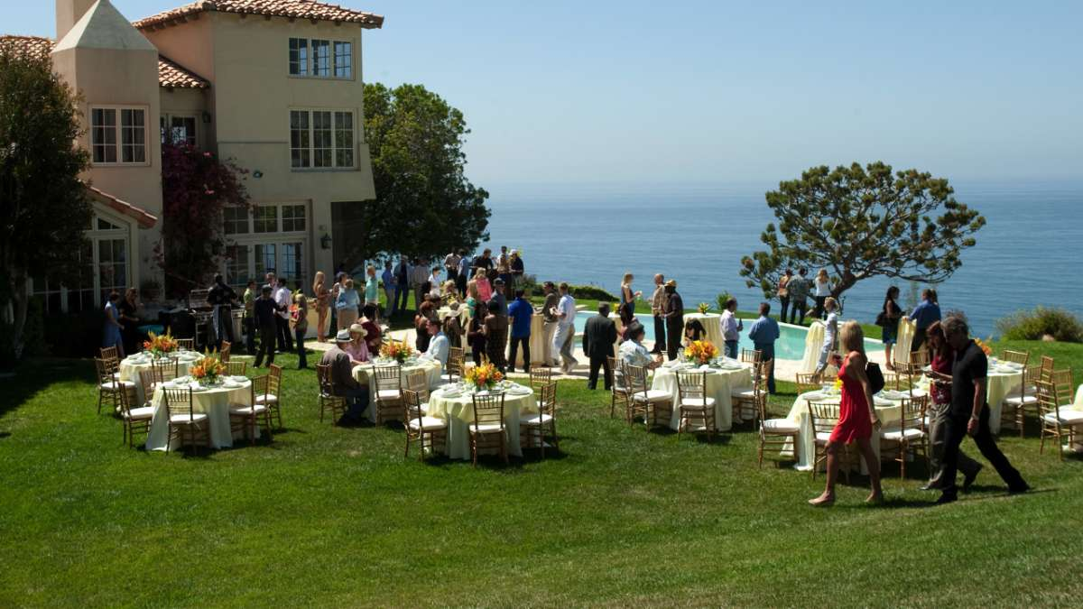 Lawn party at house by sea