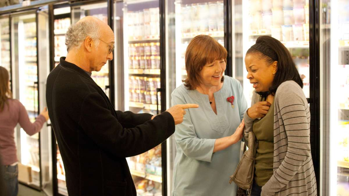 Larry in grocery store with women from safe house
