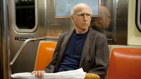 Larry on subway with bread loaf