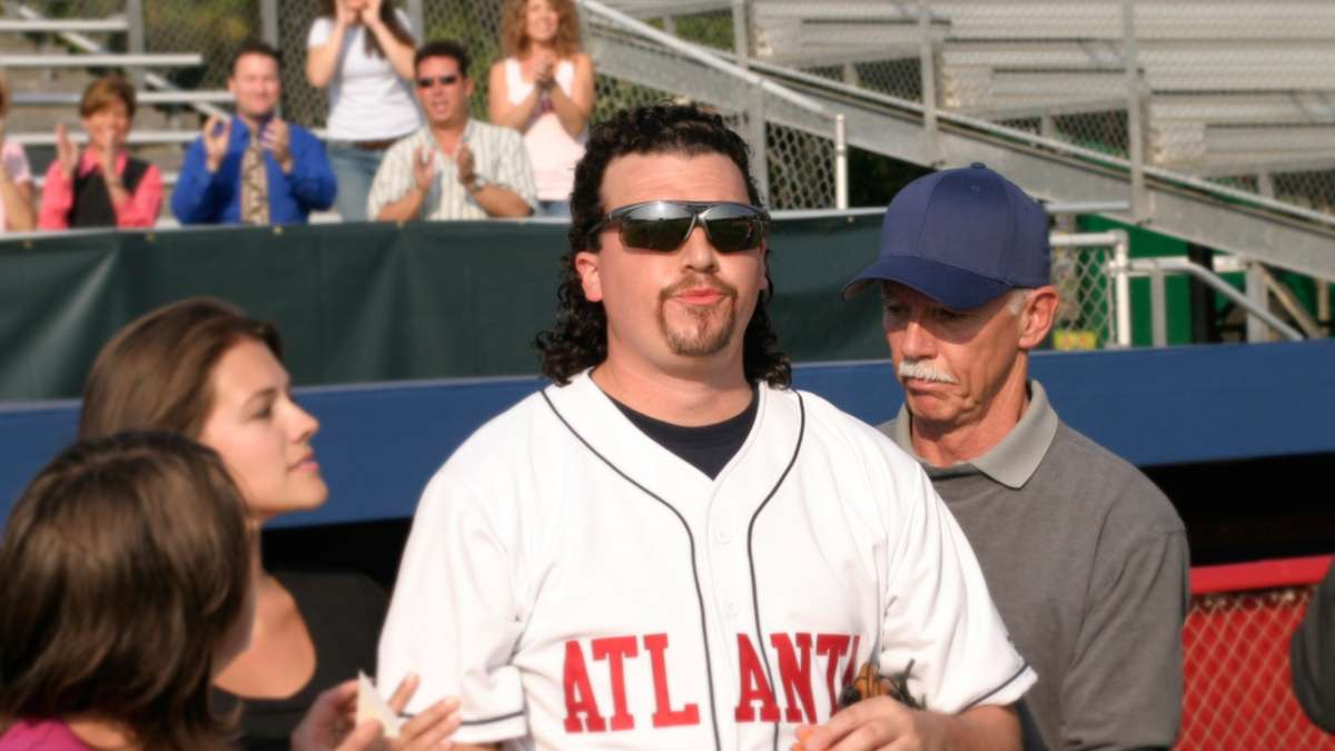 Kenny Powers in baseball uniform with admirers
