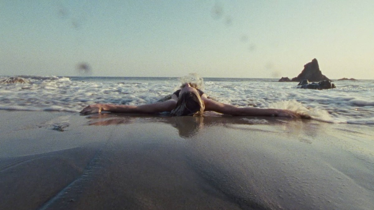 Jules lying on the beach in the tide euphoria hbo