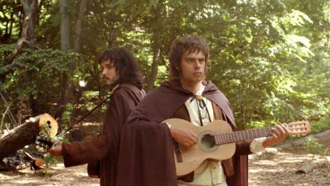 Bret and Jermaine dressed as hobbits with guitars