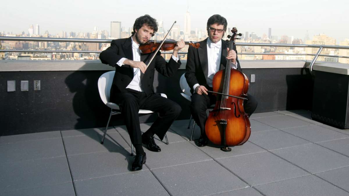 Brett and Jermaine play violin and cello on rooftop