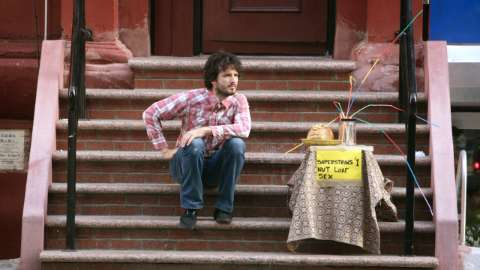 Bret sits on stoop with table