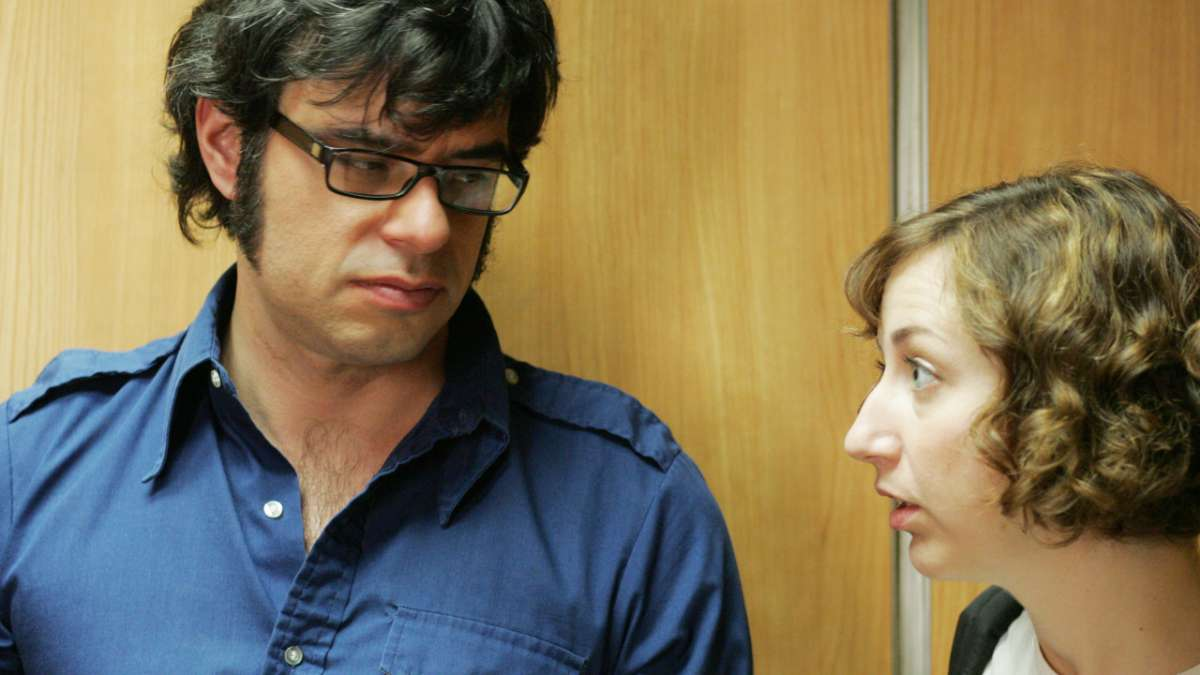 Jemaine and Mel in elevator