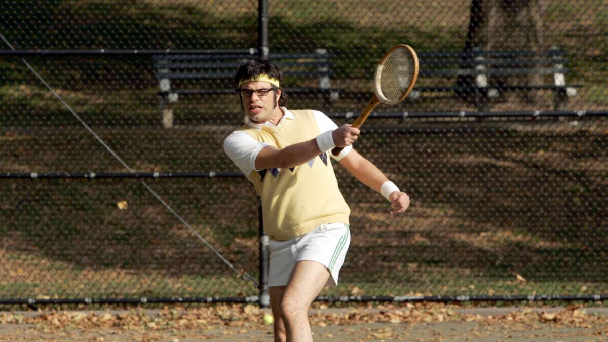 Jemaine playing tennis