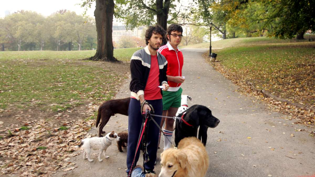 Jermaine Clement and Brent McKenzie walking dogs