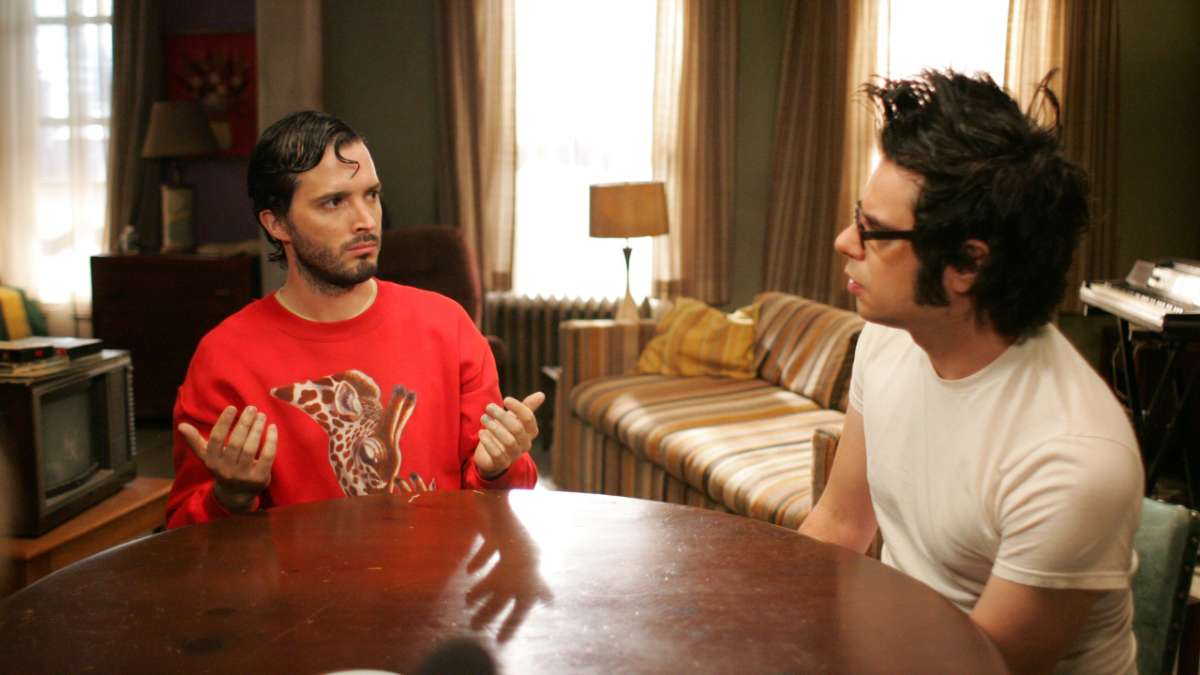 Bret and Jemaine sit at table with gel in their hair
