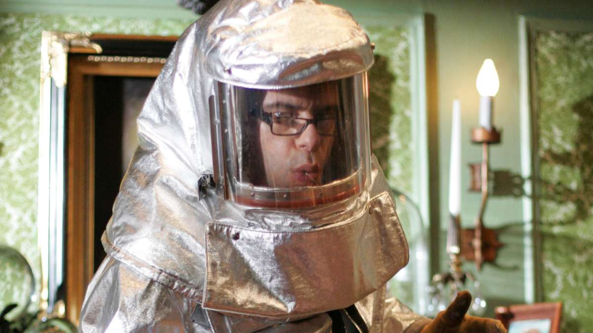 Jemaine in protective suit
