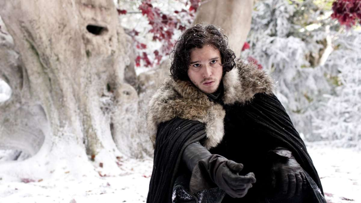 Jon Snow reaches for wolf Ghost