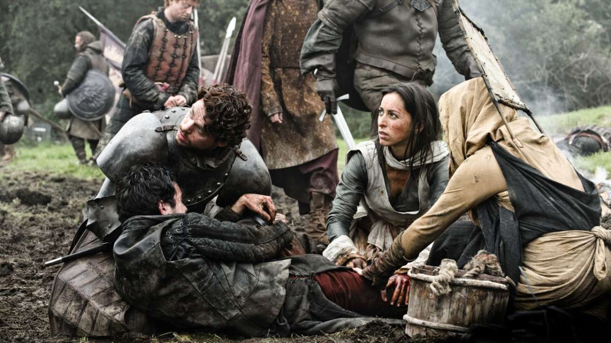 Robb helping wounded man