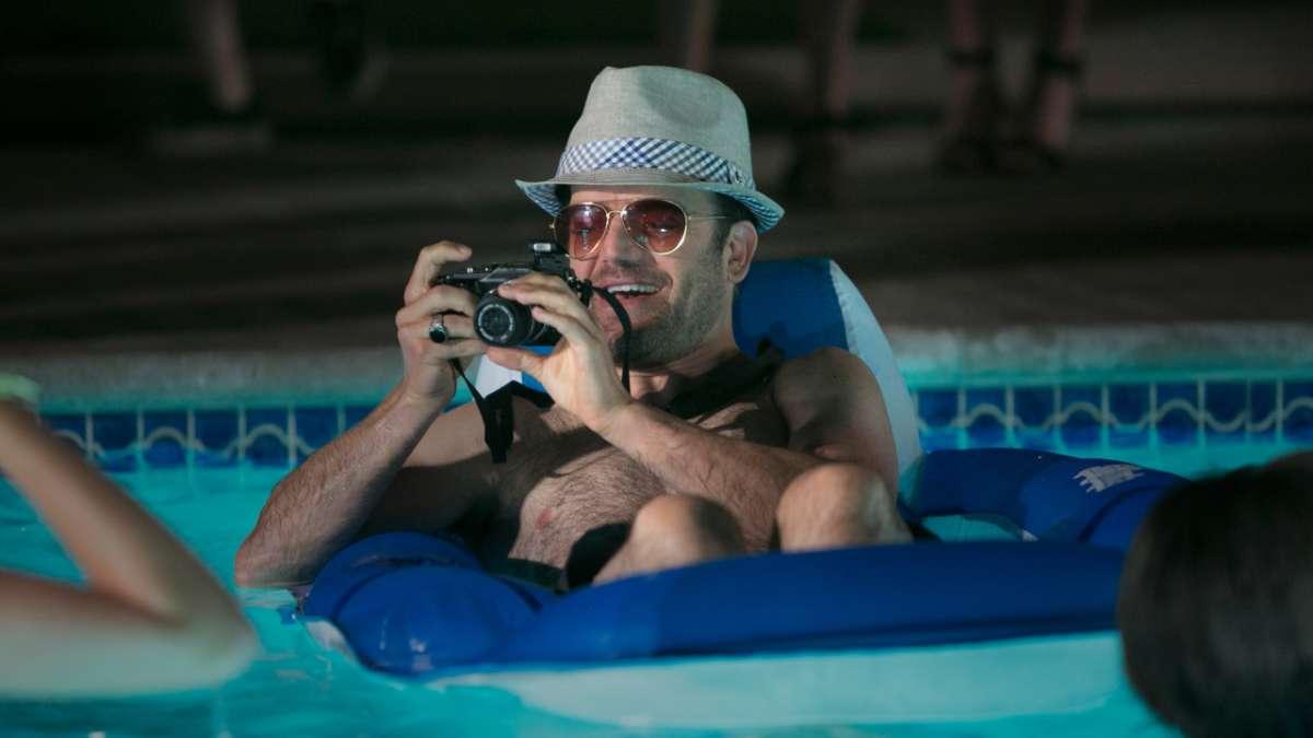 Kives at pool party with camera