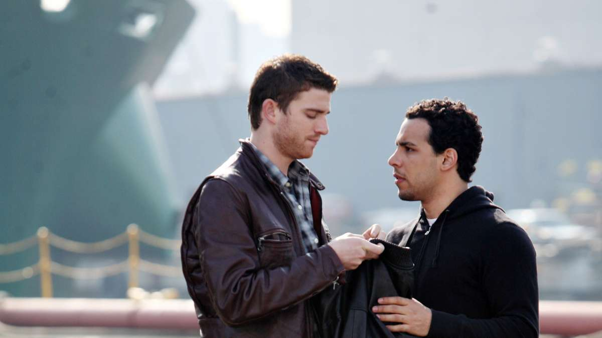 Ben and Cam examine leather jacket