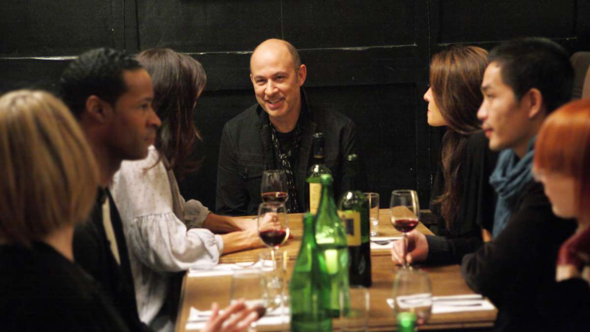 John Varvatos at table with others