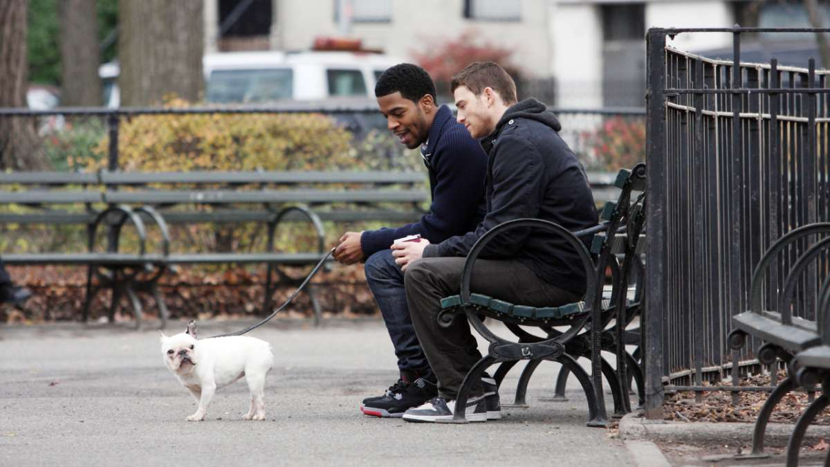 Domingo and Ben sit in park with dog