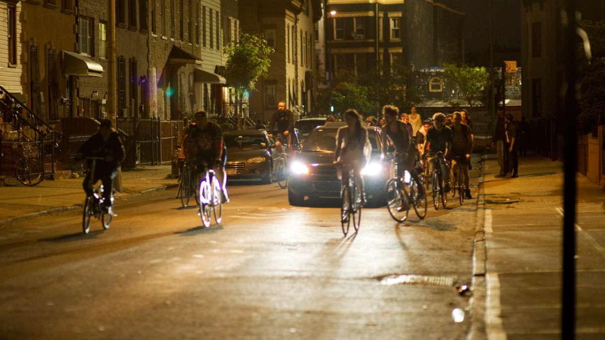 Group riding bicycles at night