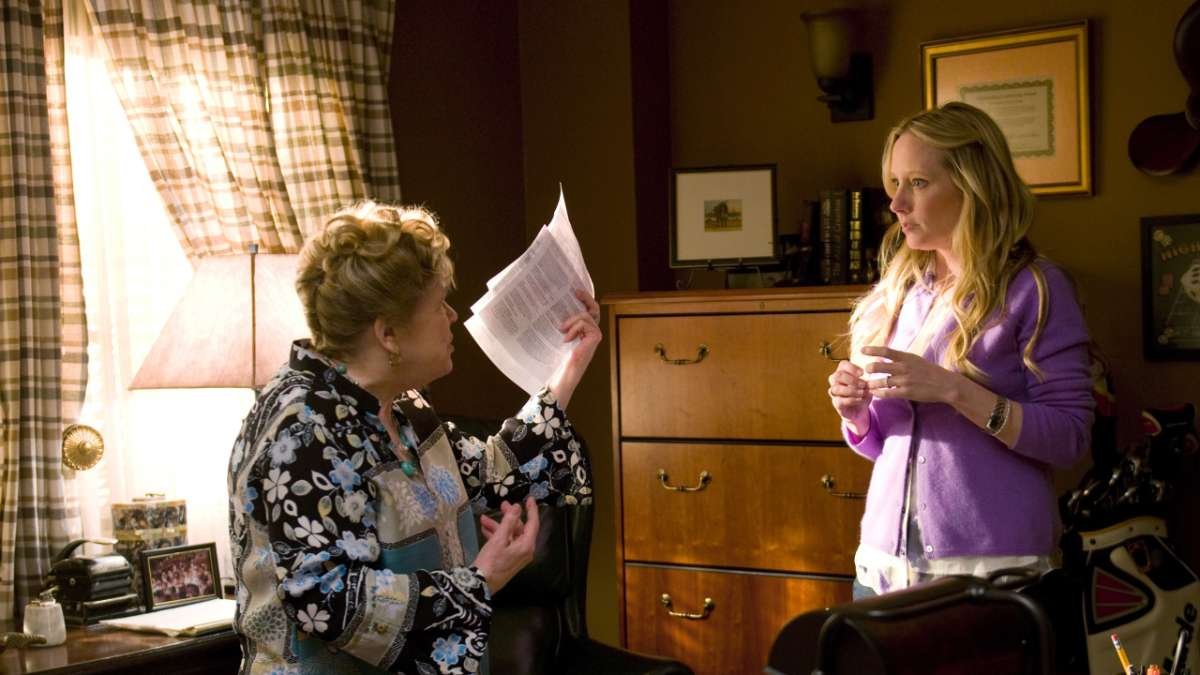 Jessica and her mother in Ronnie's office with papers