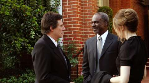 Paul Weston speaks with Alex Sr and Laura at funeral
