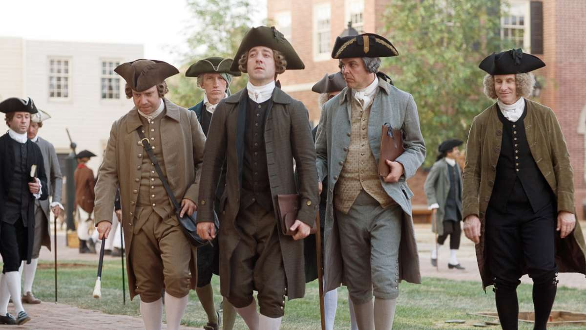 John Adams and Samuel Adams walk with others