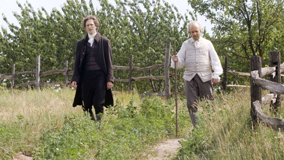 John Quincy Adams walks with John Adams in field