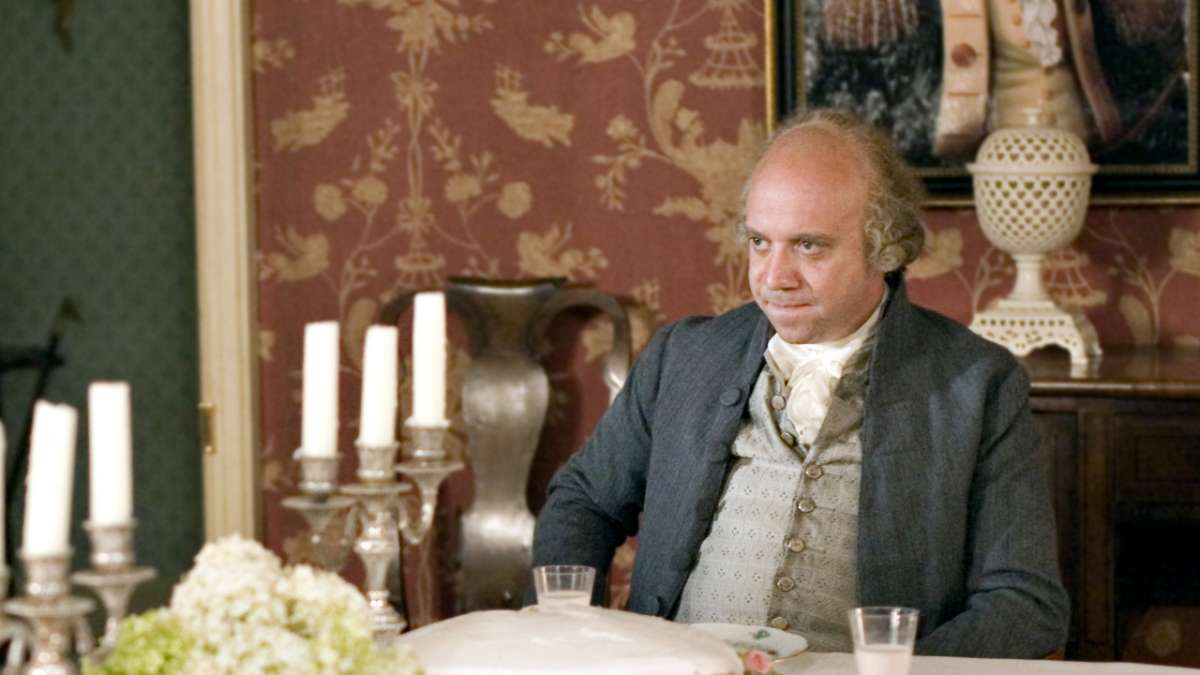 John Adams sits at dinner table