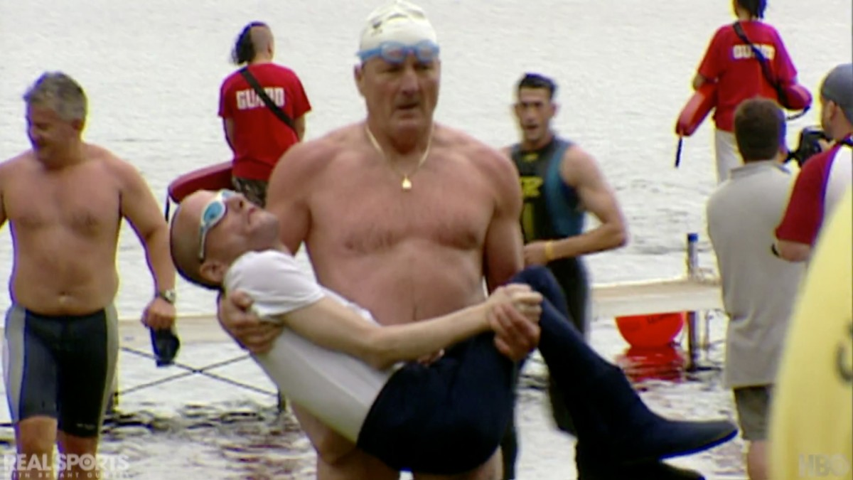 Dick Hoyt carrying his son Rick in a triathalon