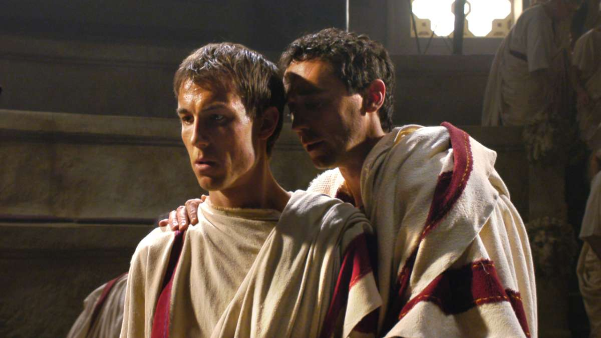 Cicero whispers to Marcus Junius Brutus