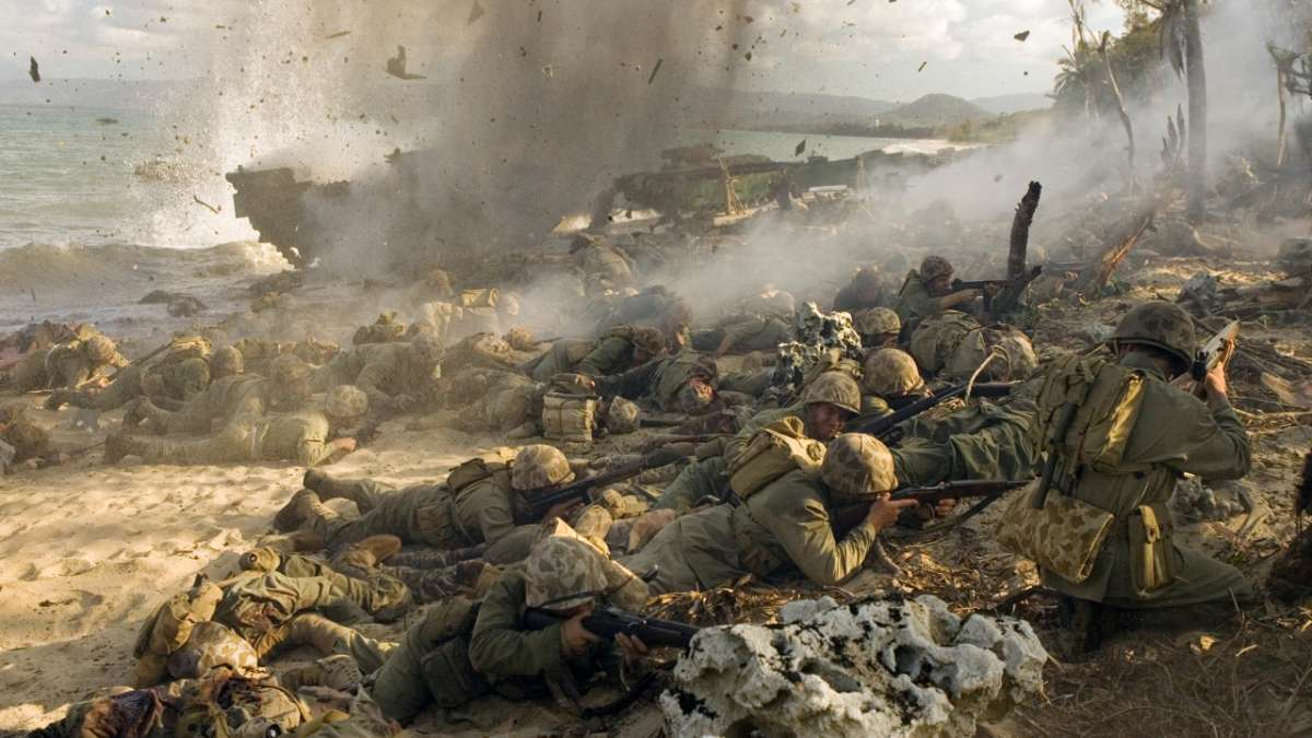 Marines take cover from artillery on beach