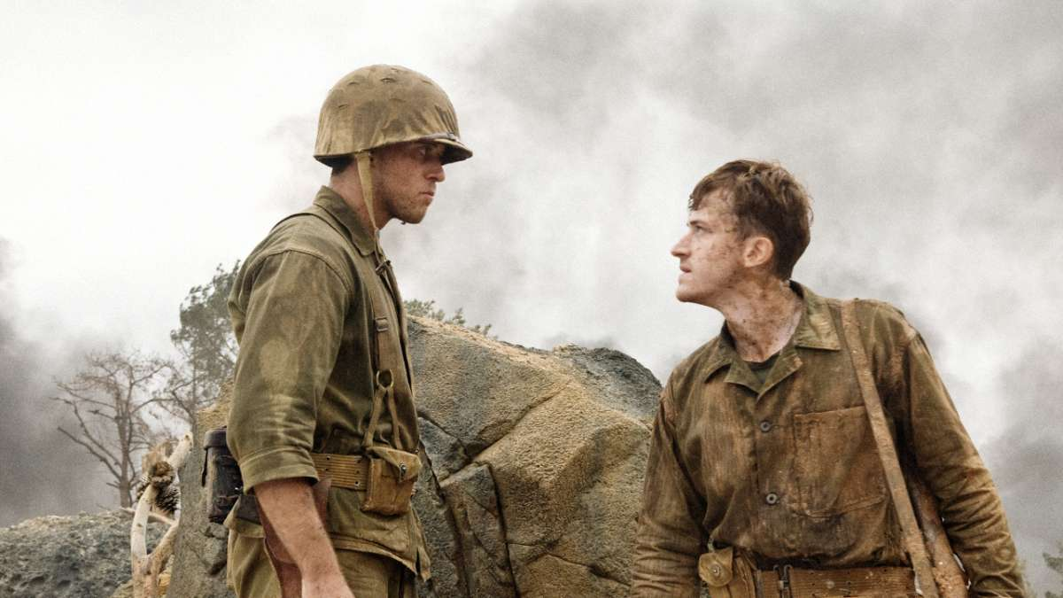 Eugene Sledge and marine stare at each other