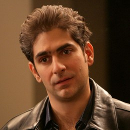 Christopher Moltisanti on phone leather jacket