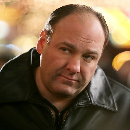 Tony Soprano jacket hands resting on shovel