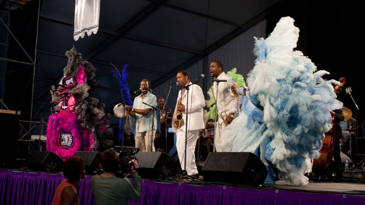 Albert and Delmond perform with band at jazz fest